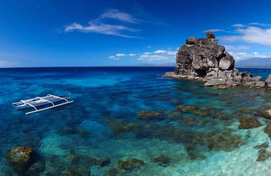 Snorkeling in the pristine waters around Apo Island