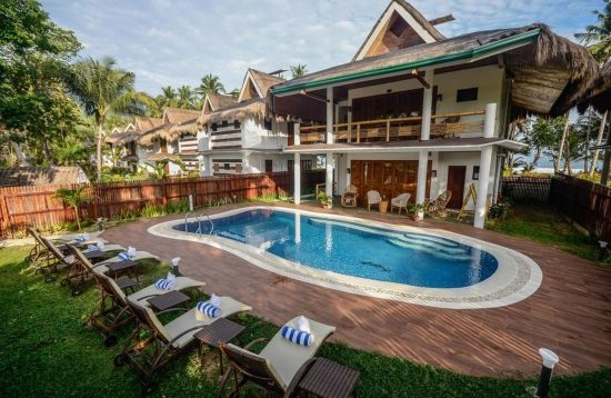 Swimming pool are and cottages at Daluyon Beach and Mountain