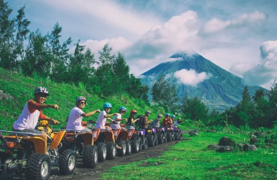 Tourists venturing to Mount Mayon on ATV
