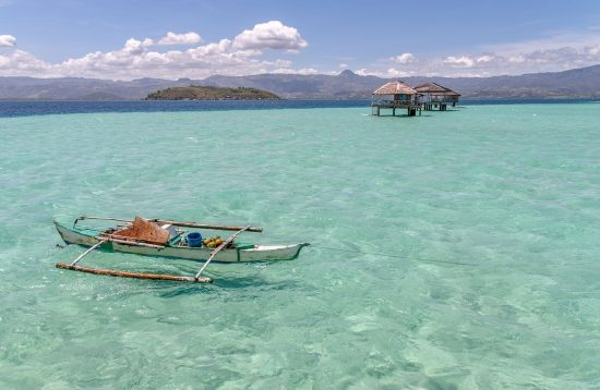 Boat floating in the clear water of Manjuyod Sandbar