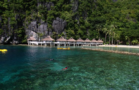 Boat approaching Maniloc Island Resort in El Nido