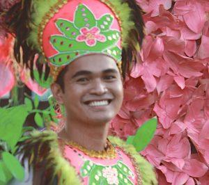 A Friendly filipino man dancing during a parade
