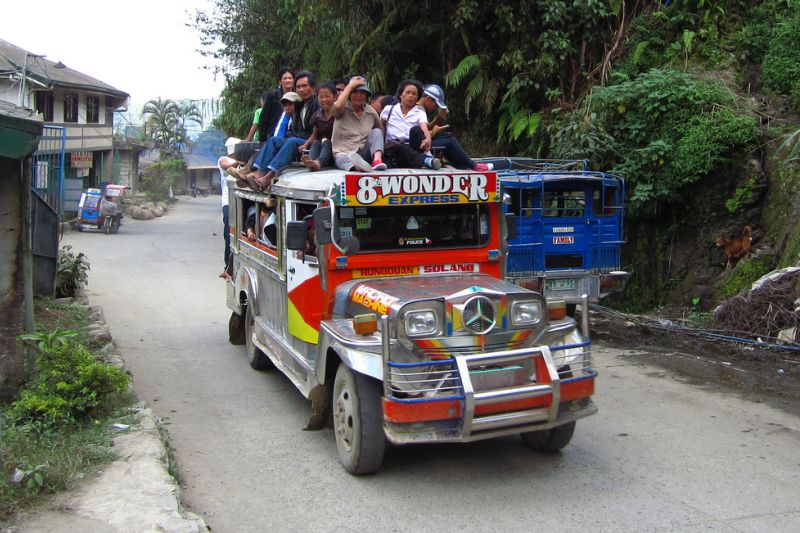 A group of local people on a jeepney