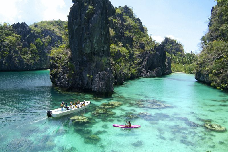 A group of tourists exploring El Nido's Big Lagoon