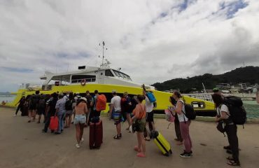 Tourists boarding Jomalia's Fast Ferry from El Nido to Coron