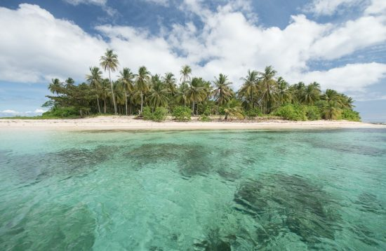 Pristine waters and white sand in Pass Island